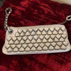 "Betsy Johnson silver clutch or wristlet 9""across"